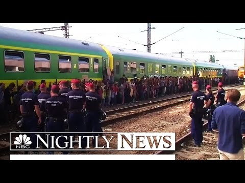 Thousands of Migrants Still Streaming Into Hungary Despite Maltreatment | NBC Nightly News