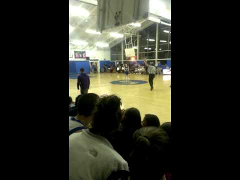 Kid Tries To Steal Ball At Varsity Basketball Game