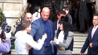 Lady Gaga kisses and hugs fans outside her London hotel