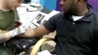 Anthony getting his first Tattoo