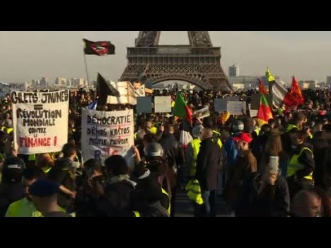 """Yellow vest"" protesters gather near Eiffel Tower in Paris"