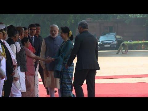 Modi greets Aung San Suu Kyi in Delhi