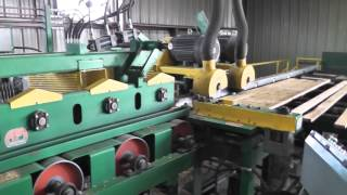 A&M Planer 2-Pineapple Rolls Feed Table and Bridge with ACS Controls running 1x4 SYP