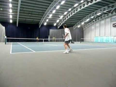 Mark & Yuen Huen Ling Playing Tennis At SportCity Manchester