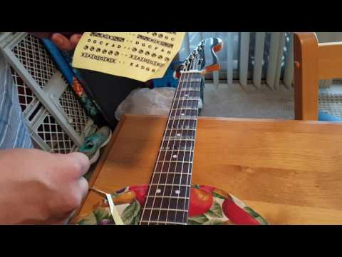 How to apply note stickers to a guitar without taking off the strings