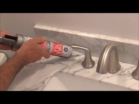 How To Apply Silicone Behind A Faucet Back Of A Sink Youtube