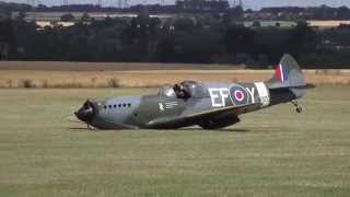 Dramatic moment a replica Spitfire lands without undercarriage