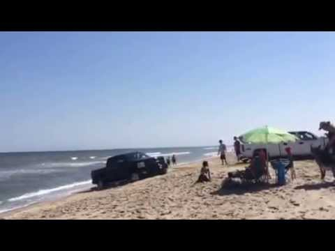 Truck Stuck in the sand almost washed away by ocean