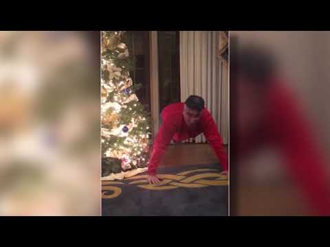 Indiana Gov. Eric Holcomb does push ups after losing bet