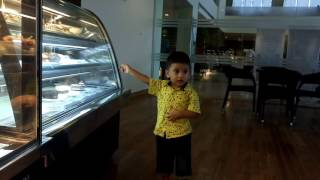 Baby asking the price of cake