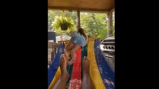 Little Girl Winds Up On The Floor While Swinging On Hammock