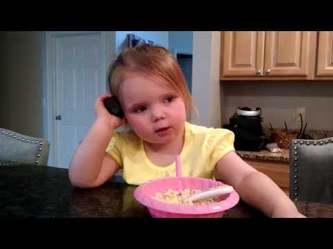 2 year old impersonates adults talking on the phone OMG