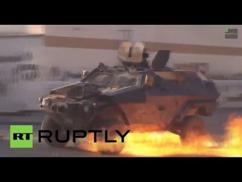 Bahrain: Watch protesters BATTER armoured vehicles with Molotov cocktails