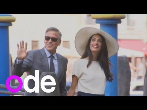 George Clooney and new wife Amal Alamuddin arrive by boat for their civil wedding ceremony