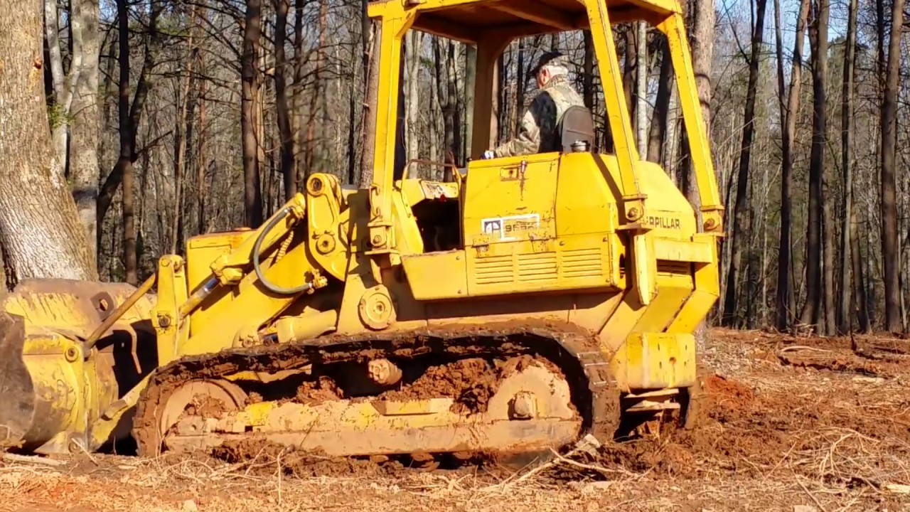 Cat 955 Clearing Land