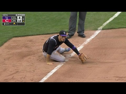 COL@CIN: Arenado makes great throw from his knee