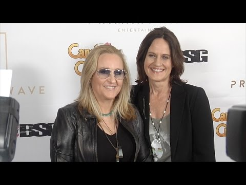Melissa Etheridge & Linda Wallem arrive at Primary Wave 10th annual pre Grammy party red carpet