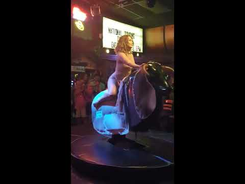 Sexy Girl in Dress Rides Mechanical bull