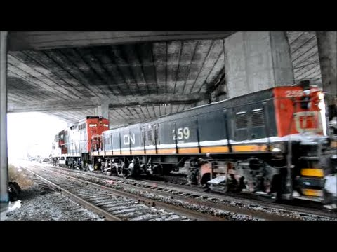 CN GP-9 LOCOMOTIVE & SLUG PASS UNDER HIGHWAY METROPOLITAN