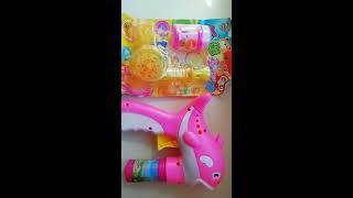 Дитячий пістолет, що стріляє мильними бульбашками. Розпакування посилки з ал