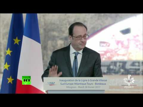 Moment police sniper fires shots during Hollande speech