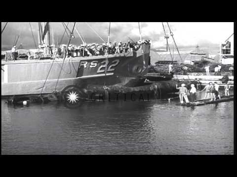 Crew aboard USS Current picks up a midget submarine with a floating crane off Pea...HD Stock Footage from YouTube · Duration:  3 minutes 19 seconds