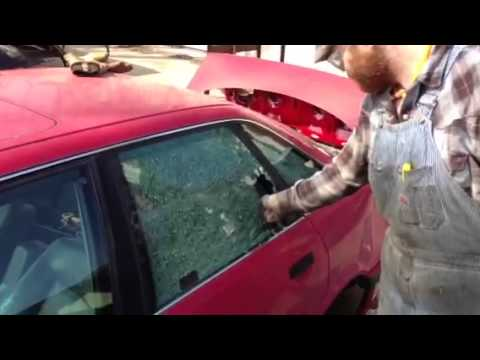 breaking a car window with a center punch -