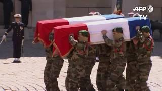 Soldats tombés au Burkina: arrivée des cercueils aux Invalides I AFP Images