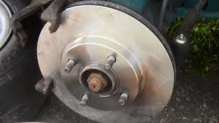 How to Remove Install Disc Brake Rotors on Mercury Mystique / Ford Contour 1995-2000