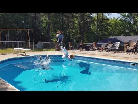 Band jumps into the pool in full show attire