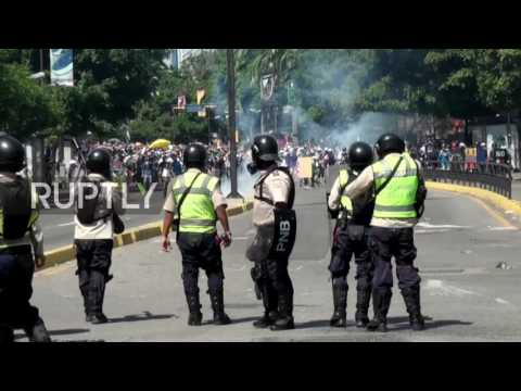 Venezuela: Fore! Protesters use golf clubs to bat away gas canisters in Caracas