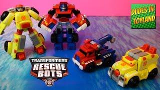 Rescue Bots Transformers toys: Optimus Prime tow truck, Heatwave Ambulance (Hoist & Medix repaints)