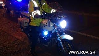 Греческий полицейский  с ленточкой цветов  русского флага на руле мотоцикла
