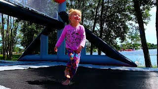 Alina jumps on giant trampoline. Outdoor pretend play with Alinka