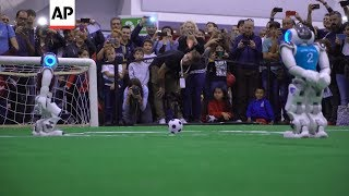 Soccer playing robots compete in Italy tournament