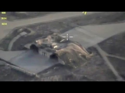 Russian drone shows Syrian air base after US strike