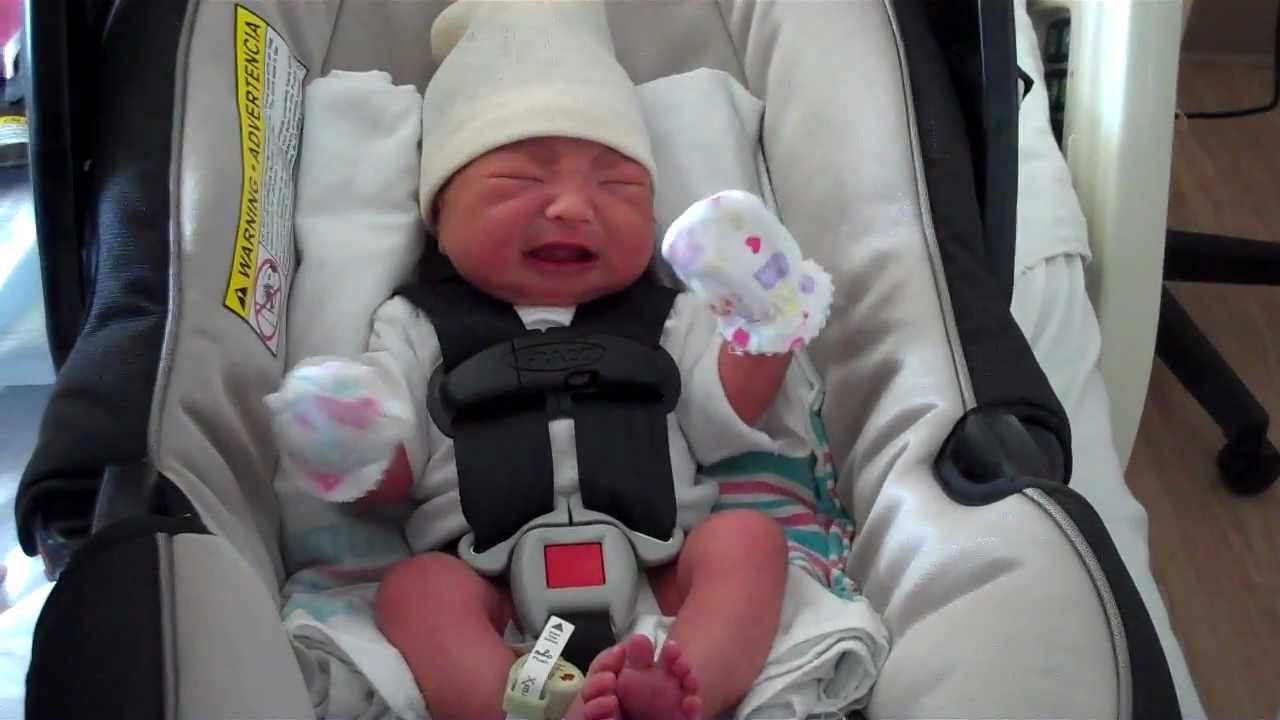 Loading baby in her car seat for the very first time - YouTube