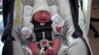 Loading baby in her car seat for the very first time
