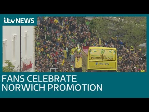 Norwich City fans turn out in force for promotion parade | ITV News