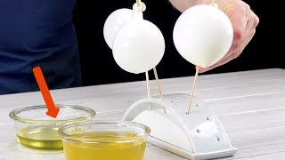 將氣球塗上油和吉利丁,然後用夾子完成。成品是驚人的!
