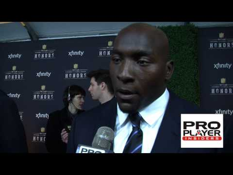 Colts Robert Mathis and Wife at 2014 NFL Honors Talk 100 Sack Season and Fashion