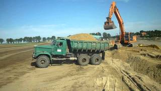 Kraz And Doosan In gravel pit
