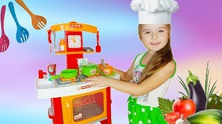Children's kitchen with appliances. Unpacking and Review
