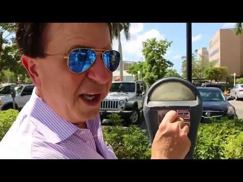 Investigating parking meters in downtown Fort Myers