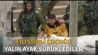 İsrailli askerler 8 yaşındaki Filistinli çocuğu yalın ayak sürükledi
