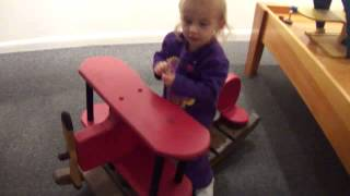 Trying Out The Wooden Rocking Airplane