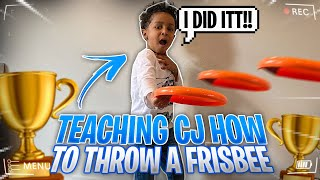 CJ LEARNS HOW TO THROW A FRISBY..