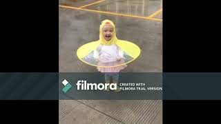 Must Watch !! Baby Girl Running In Rain. Looking like yellow bird