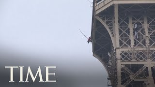 Eiffel Tower Evacuated And Closed Down After Man Began Scaling The Paris Landmark | TIME