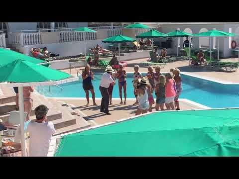 Barman dancing at pool - Family village Mitsis hotels Kos Greece